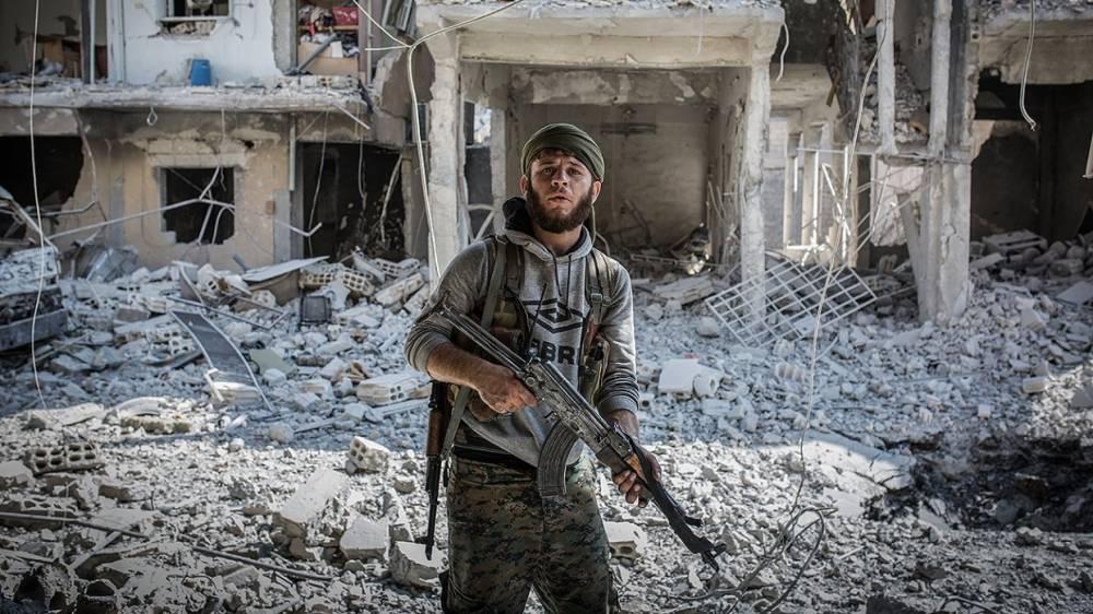 Боевики ИГ и проамериканские курды заключили тайное соглашение в Ракке