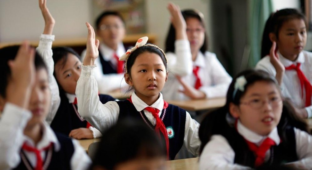 В Китайских школах около 300 детей-христиан заставили указать в анкете «неверующий»