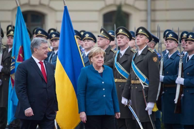 В Киеве Ангелу Меркель обвинили в потере Украиной Крыма и Донбасса