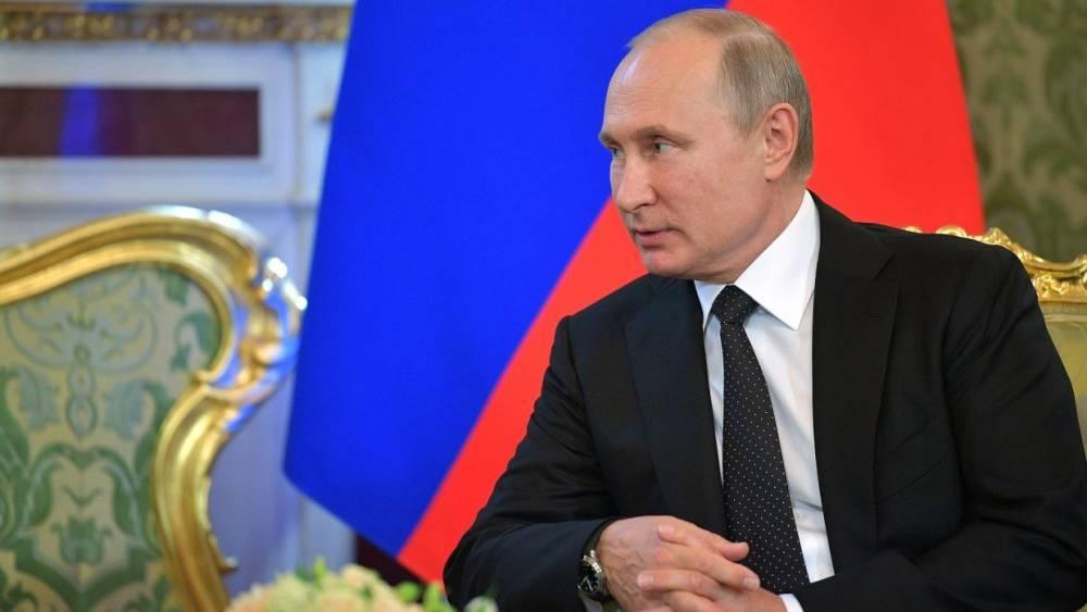 Путин пообщался с бывшим главой Мадагаскара в кулуарах Большого театра