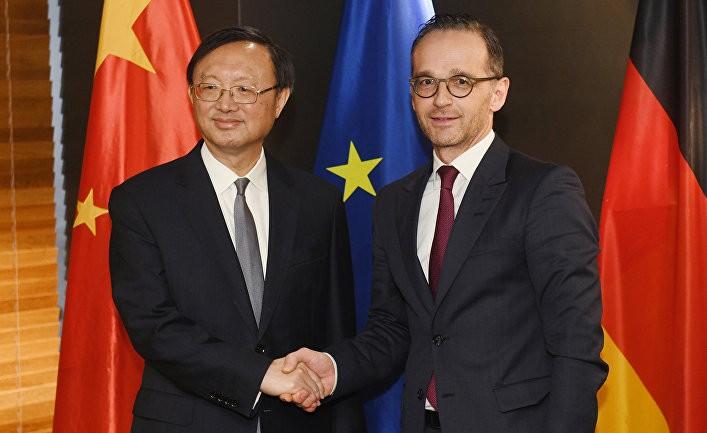 Time: Россия и Китай вбивают клин между охладевшими друг к другу Америкой и Европой
