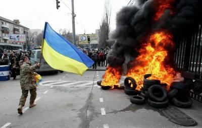 Политолог: вооруженный конфликт на Украине приведет к распаду страны